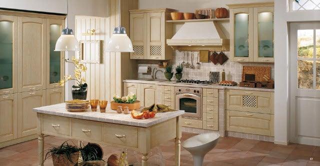 Несмотря на жизнерадостность стиля в интерьере кухни используется не более трех основных цветов