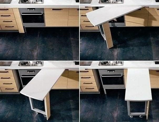 Отличным решением на небольшой кухне использовать выдвижной стол, который может использоваться в качестве дополнительной рабочей зоны