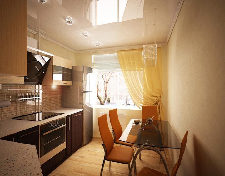 Кухня будет казаться больше и просторнее, если использовать не большое количество элементов и легкие шторы