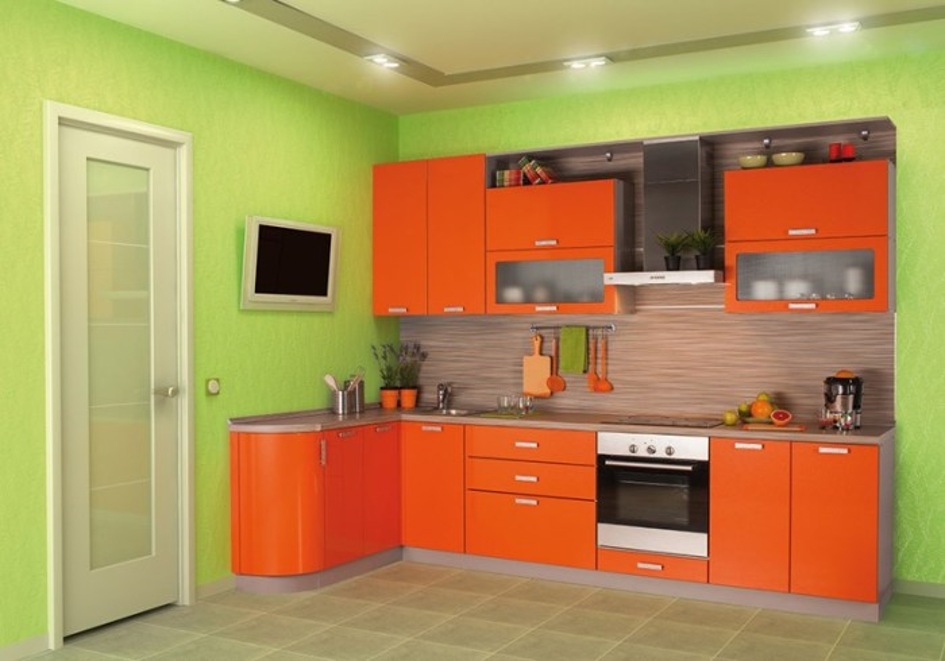 Светло-зеленый цвет стен удачно вписывается с ярким мебельным гарнитуром