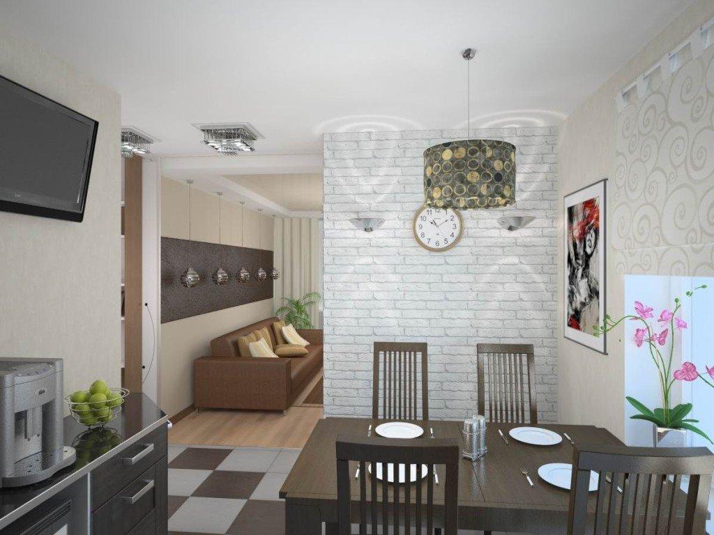 Участок стены, отделяющий столовую зону кухни от пространства гостиной, облицован белой гипсовой плиткой, контрастирующей с темной мебелью