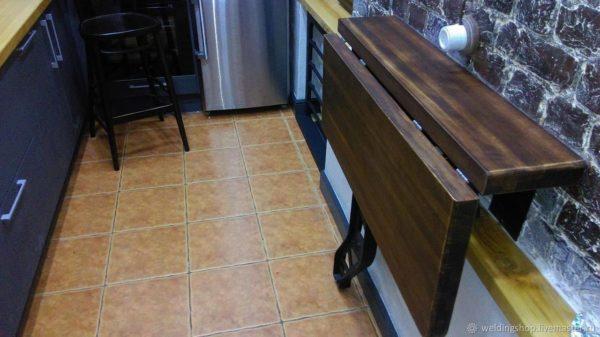 Дизайн маленькой кухни с барной стойкой вместо стола