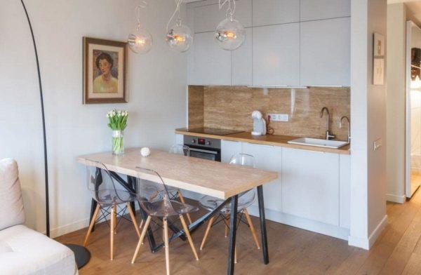Стандартное расположение прямого кухонного гарнитура в кухни - студии