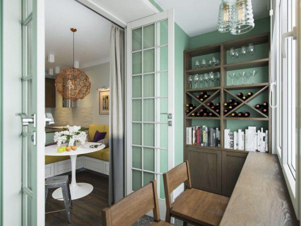 Балкон в кухне студии использован под хранение и барную стойку